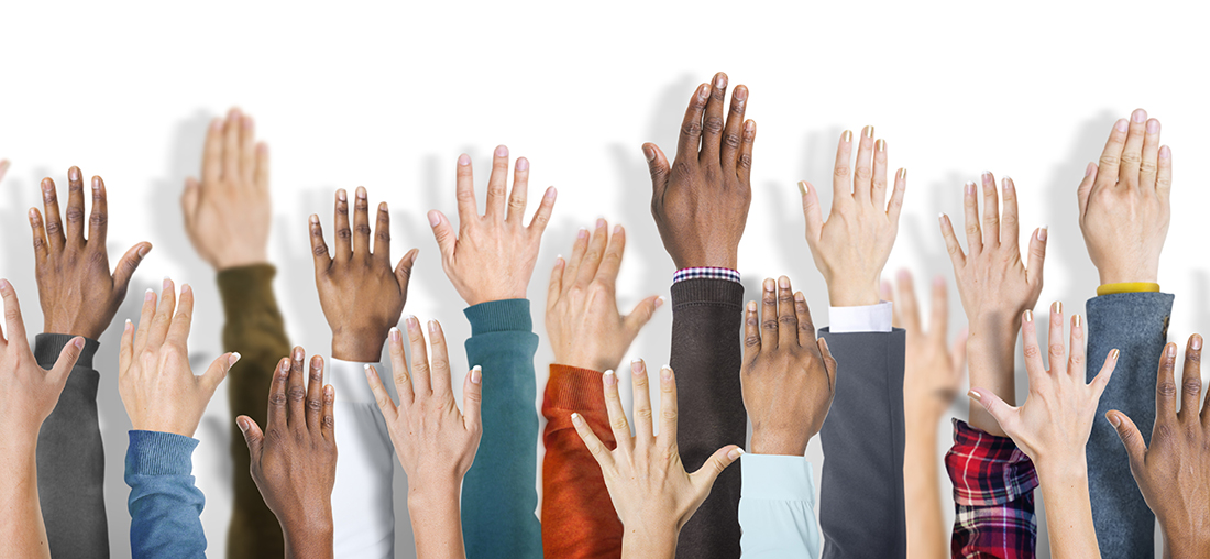 photo of people raising hand to advocate